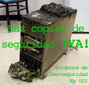 """Carátula del episodio 2 de Bitácora de Ciberseguridad que muestra una torre de computadora quemada sobre la que se muestra un texto: """"Haz copias de seguridad ¡YA!"""""""